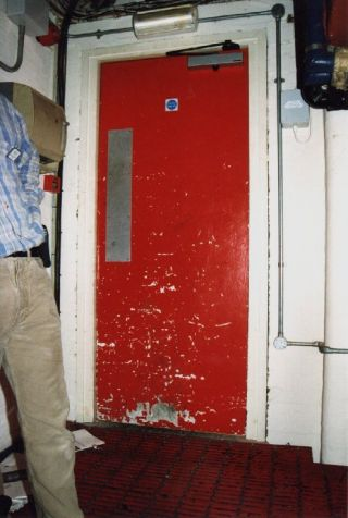 Fire door with painted but damaged AIB